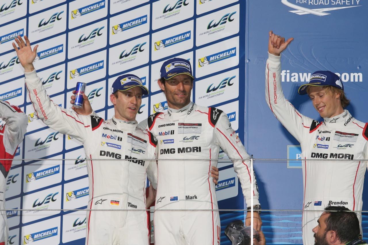 (L to R): Race winners Timo Bernhard (GER) / Mark Webber (AUS) / Brendon Hartley (NZL) #17 Porsche Team Porsche 919 Hybrid celebrate on the podium. 11.10.2015.