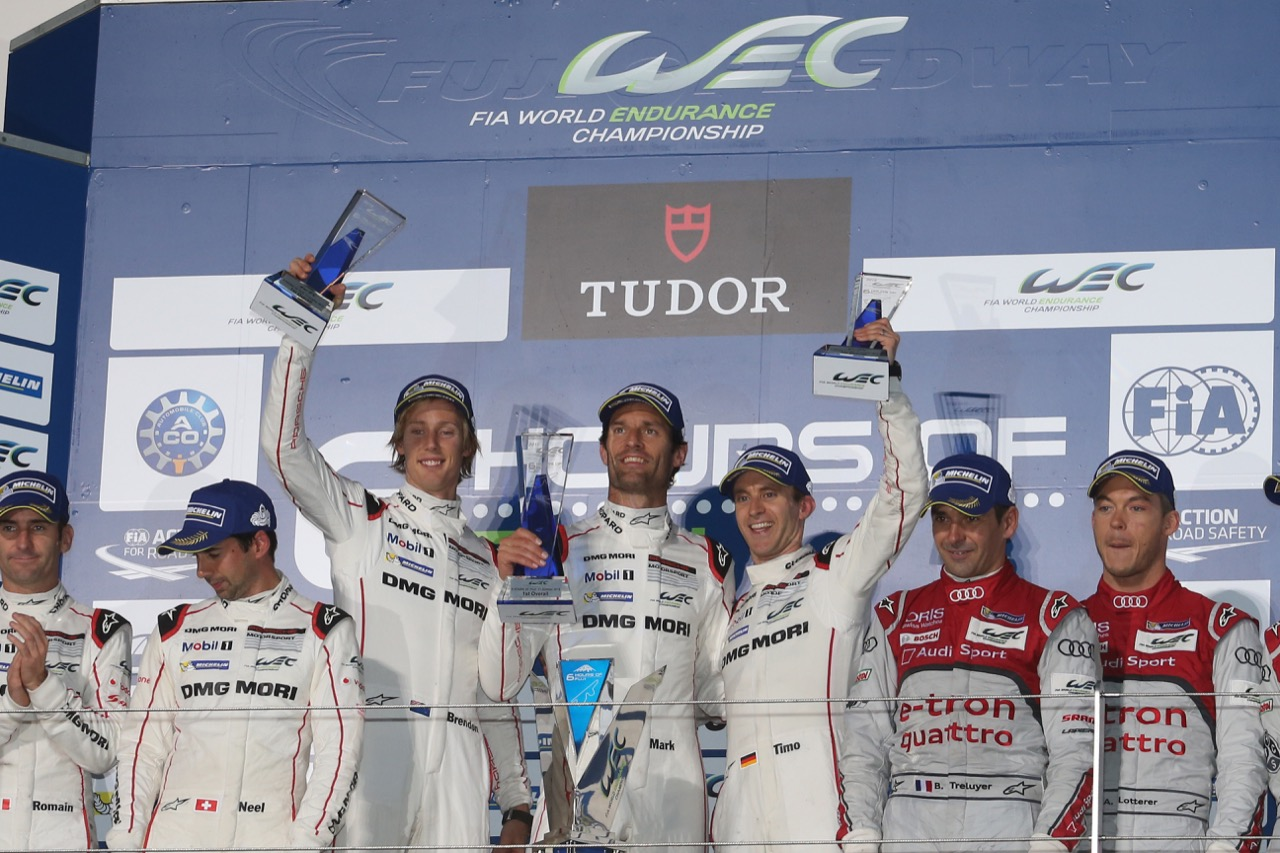 (L to R): Race winners Timo Bernhard (GER) / Mark Webber (AUS) / Brendon Hartley (NZL) #17 Porsche Team Porsche 919 Hybrid celebrate on the podium. 11.10.2015.